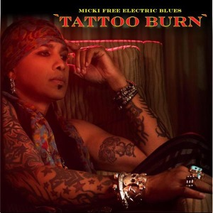 micki free electric blues tattoo burn