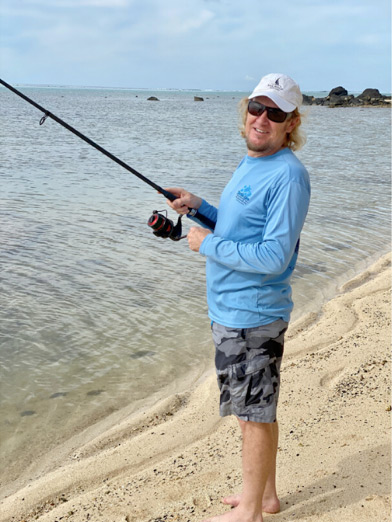 Photo of Adrian Smith fishing