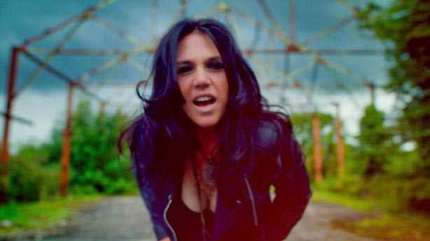 Still of Sari Schorr from The New Revolution video