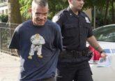 Harley Flanagan is led into custody