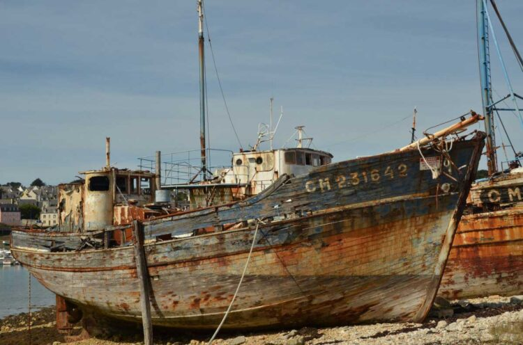Photo of a round fishing boat.