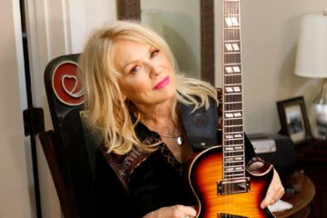 Photo of Nancy Wilson, and her custom designed Epiphone Nancy Wilson Fanatic guitar